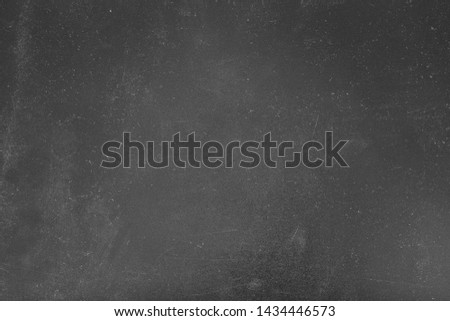 Dust and scratches design. Faded black background. Aged gray surface. Copy space.