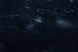 Dust and scratches on black surface. Abstract background. Texture layer for photo editor. Old grunge filter effect.