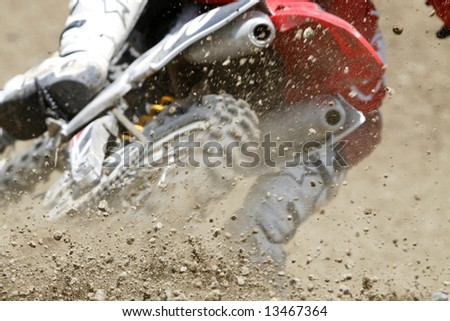 dust and small stones during a motocross race