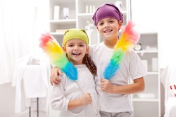 Dust cleaning taskforce - boy and girl with duster brushes