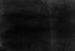 Dust scratched overlay. Weathered chalkboard. Black distressed aged stained surface with gray smeared dirt grainy particles noise effect.