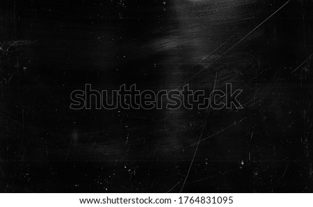 Dust scratches background. Grain texture. Black distressed surface with white smeared stains. Foto stock ©