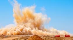 Dust storm after the detonator blast on the construction site