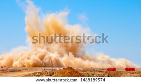 Dust storm after the detonator blast on the construction site  Stockfoto ©