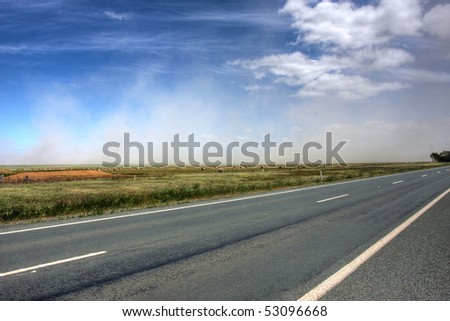 dust storm over an australian road