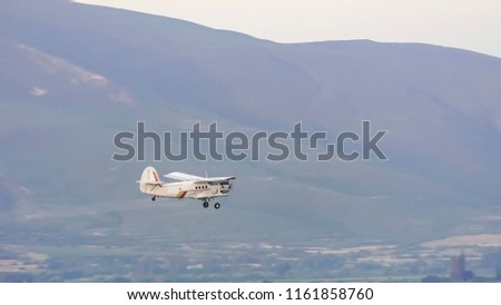 Aerial View of a crop duster spraying a farm field Images and Stock
