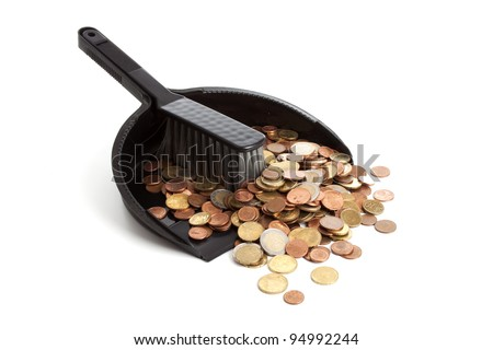 dustpan and brush  with money on a white background