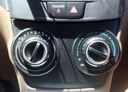 dusty air conditioner control panel on a car