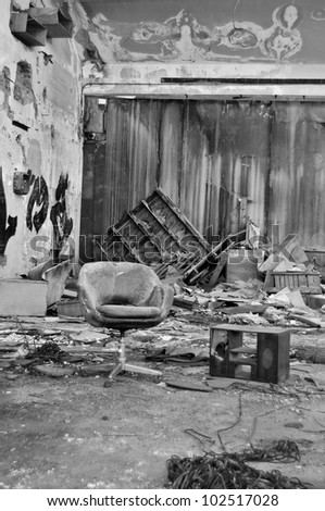 Dusty chair in abandoned vinyl records pressing factory. Black and white.