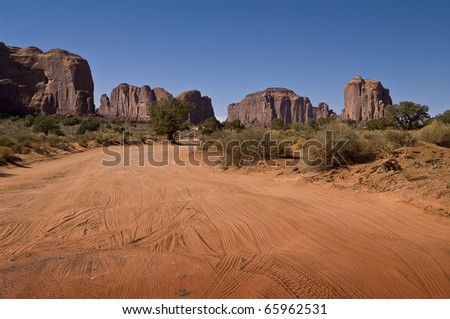Dusty road in monument valley - stock photo