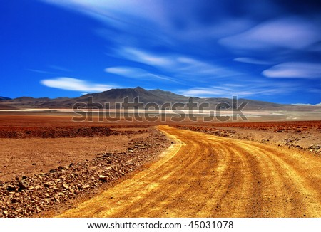 dusty road in the middle of bolivian's desert background