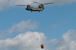 Dutch air force helicopter performing a fire fighting demonstratioin in The Netherlands