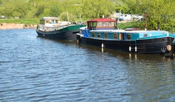 Dutch barges moored on a river