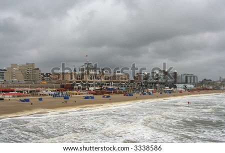 Dutch beach resort with famous Kurhaus hotel in rough weather