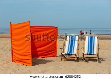 Dutch beach with colorful chairs and wind shield