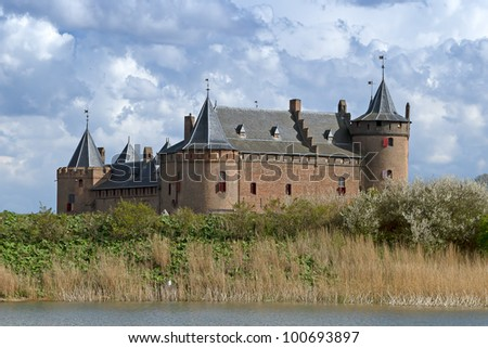 Dutch castle Muiderslot in village Muiden in Holland