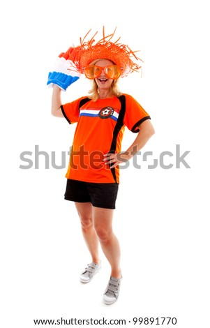 Dutch female soccer supporter in orange outfit with big blown up hand ready for the match over white background