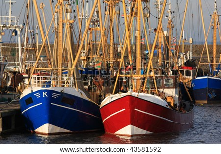 Dutch fishing boats near the Wadden Sea on a winter day.