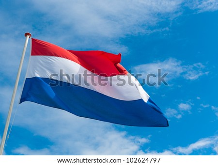 dutch flag blowing in the wind - stock photo