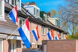 Dutch Flags hanging outside houses in Alkmaar, Netherlands to celebrate King's Day on April 27, a national Holiday in The Netherlands and birthday of King Willem-Alexander