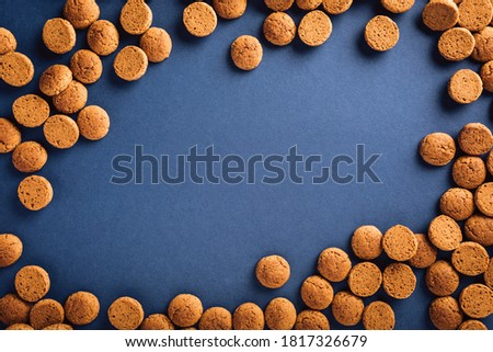 Dutch holiday Sinterklaas background with kruidnoten cookies and traditional hollands sweets. Concept for children party Saint Nicholas day five december with copy space. Top view, overhead. Stock photo ©