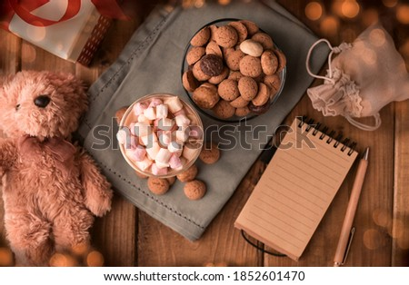 Dutch holiday Sinterklaas. kruidnoten cookies sweets, cocoa with marshmallows, gift and a letter for Saint Nicholas. Children party Saint Nicholas day five december. Copy space Stock photo ©