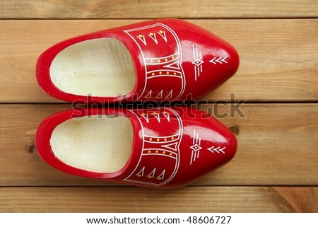 Dutch Holland red wooden shoes on wood background