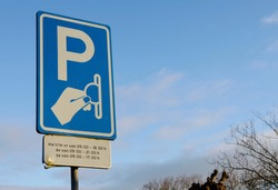 Dutch information and warning sign that told you its an paid parking lot.
