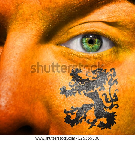Dutch Lion painted on orange face with green eye