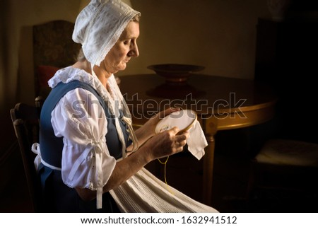 Dutch master style portrait of a woman with her embroidery work