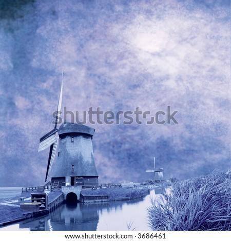 dutch mills on grungy blue background