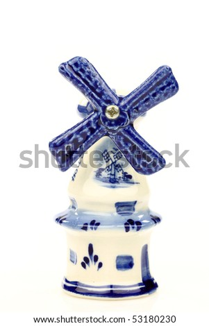 Dutch mini porcelain windmill on a white background