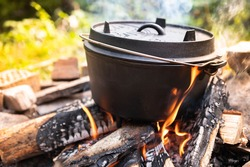 Dutch oven cooking on a campfire