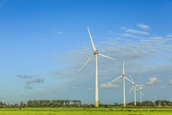 Dutch polder landscape with modern windturbines for the sustainable production of electricity for the climate-neutral production of Heineken Beer for the Dutch and European markets