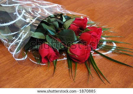 Dutch red roses on a wooden table