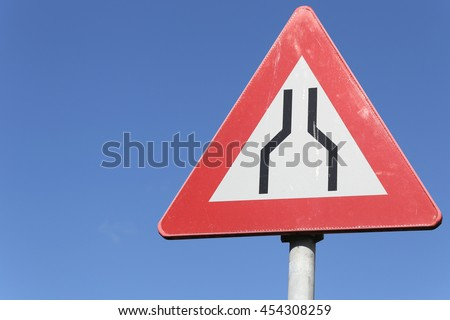 Dutch road sign: road narrows on both sides