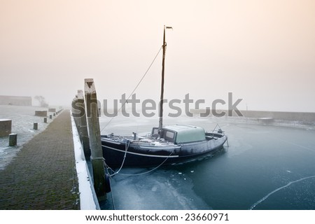 Dutch sailing boat on a cold day in winter (Friesland, The Netherlands)