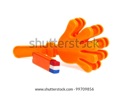 Dutch soccer accessories over white background, klapper hands and facial paint