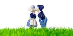 Dutch souvenir boy and girl kissing on grass