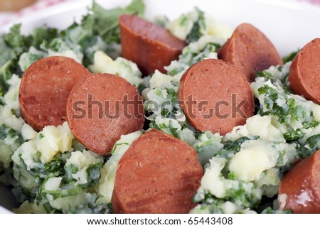 Dutch stamppot, mashed potatoes with kale, topped with vegetarian sausage.