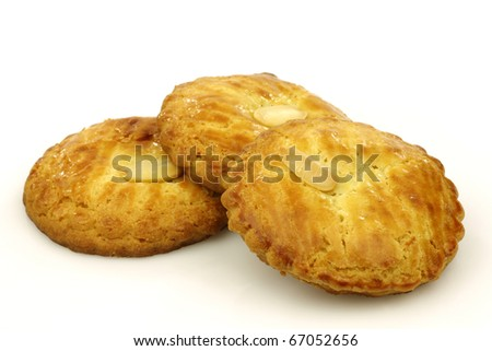 "Dutch traditional cookies called ""gevulde koek"" on a white background"