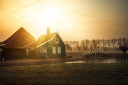Dutch traditional green wooden houses in the rural area of the Netherlands