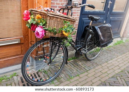 Dutch transport bike with basket and cheerful flowers