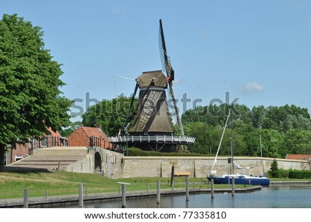 Dutch wind mill at water side