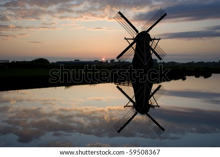 Dutch windmill on sundown