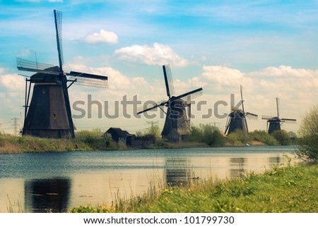 "Dutch windmills in ""Kinderdijk"", a famous village in the Netherlands where you can visit the old traditional windmills"