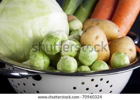 Dutch winter vegetables including carrots, potatoes, brussel sprouts, cabbage and leeks. Focus on the brussel sprouts