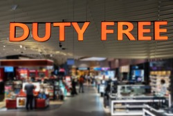Duty Free shopping, Abstract blur shopping mall and department store at an Airport. Duty free sign in focus