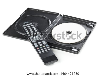 DVD, CD-ROM or Blu-Ray disc with tv or disc player remote control and plastic box on white background. Home theatre movie or series concept.
