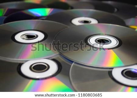 dvd disks on a black background